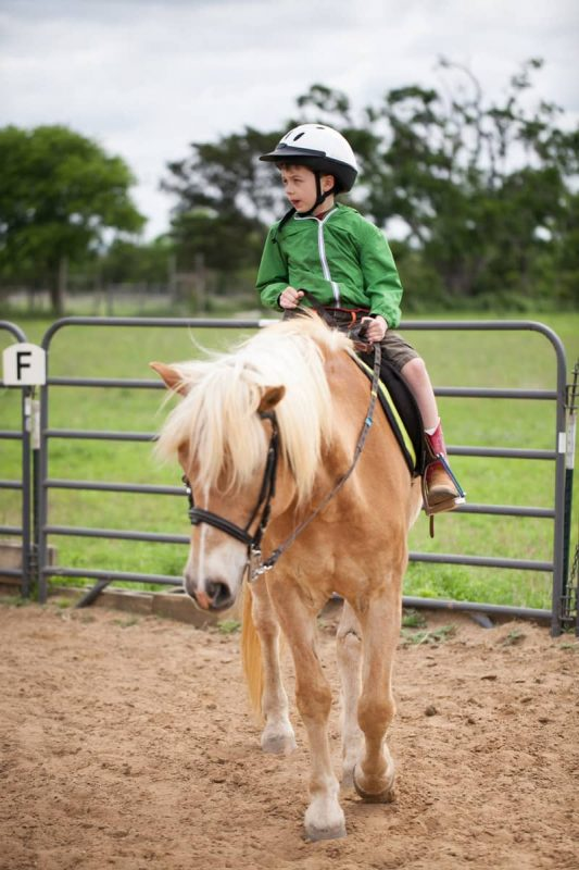 Therapeutic Riding - Child riding a horse